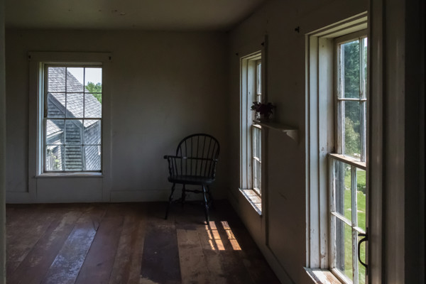 01 - Sunlit bedroom with a view of the outer rooms
