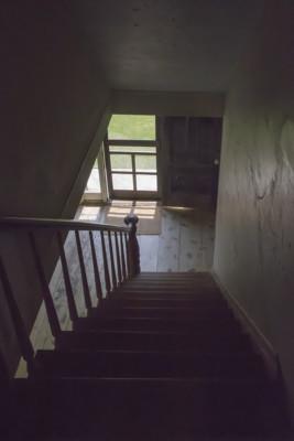 02 -Dark stairway down to sunlit front door